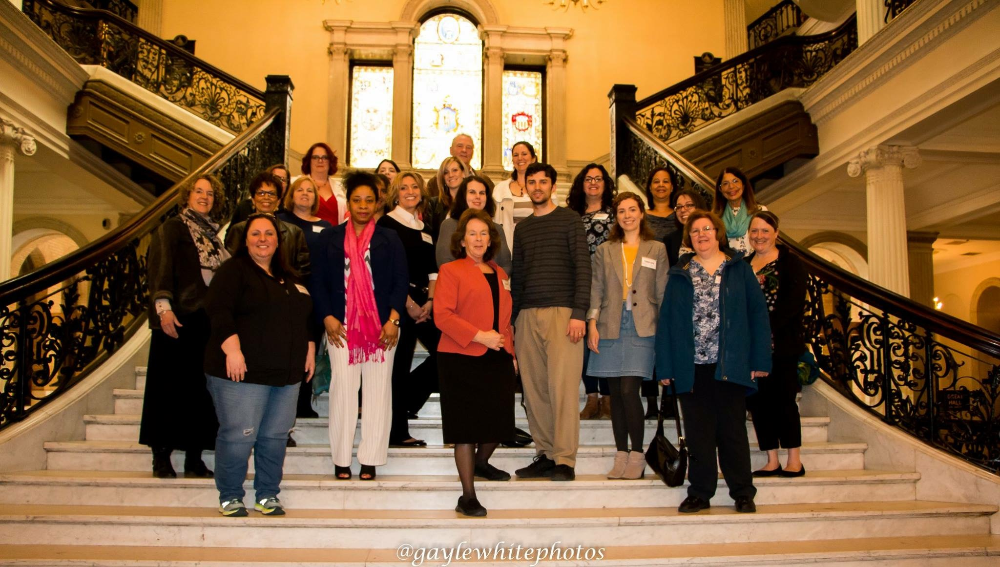 Photo: Members of Massachusetts Families Organizing for Change (MFOFC) in the state Capitol.