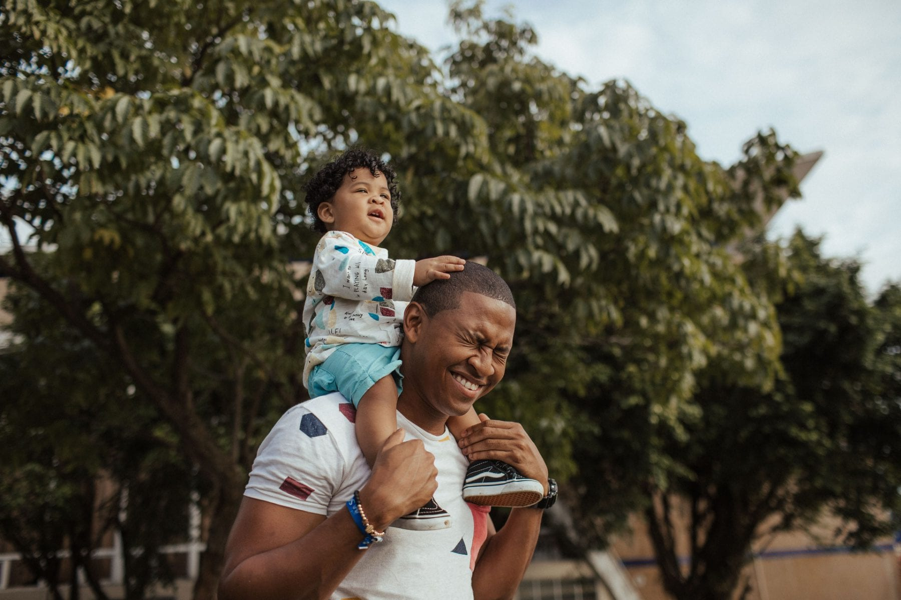 Man carrying child on his shoulders
