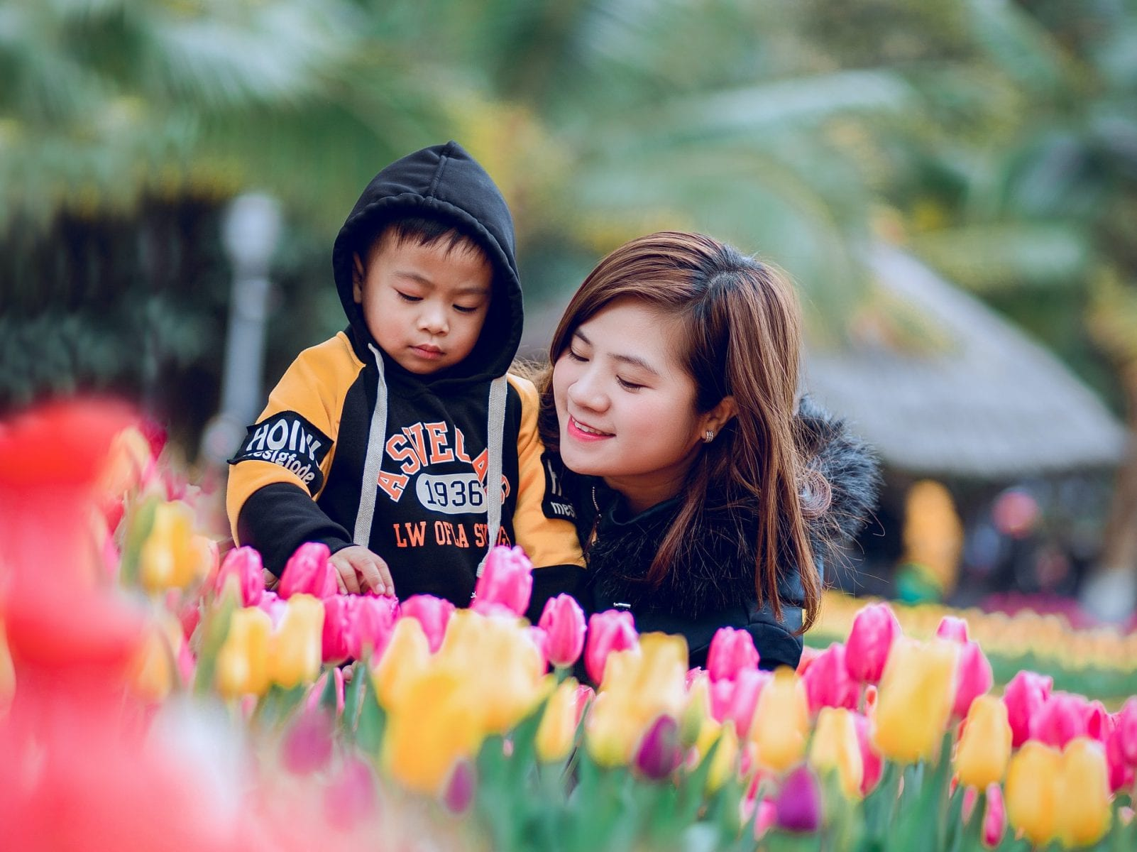 child and woman in tulips